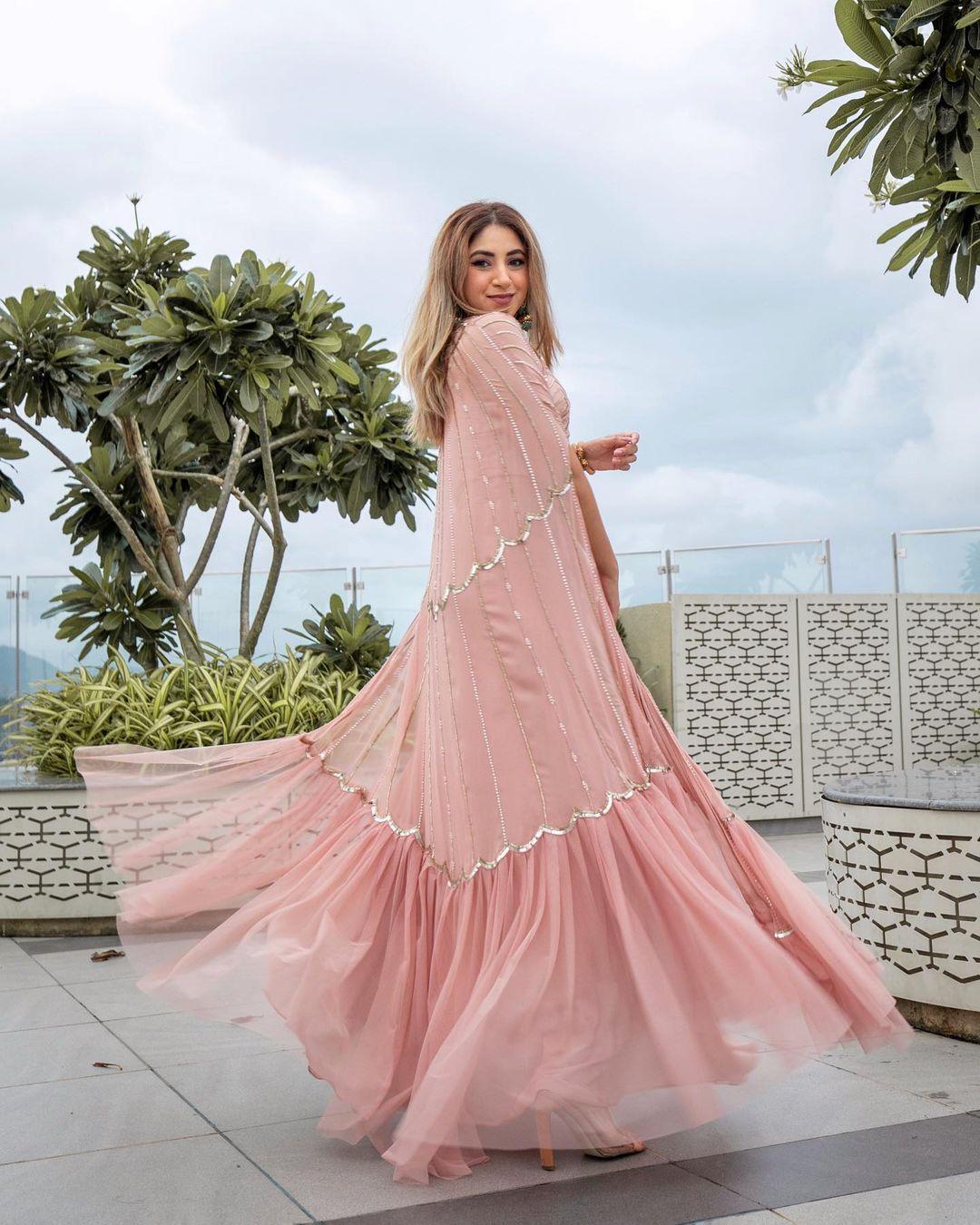 Aashna Shroff giving us major bridesmaid goals in in this peach colored lehenga.