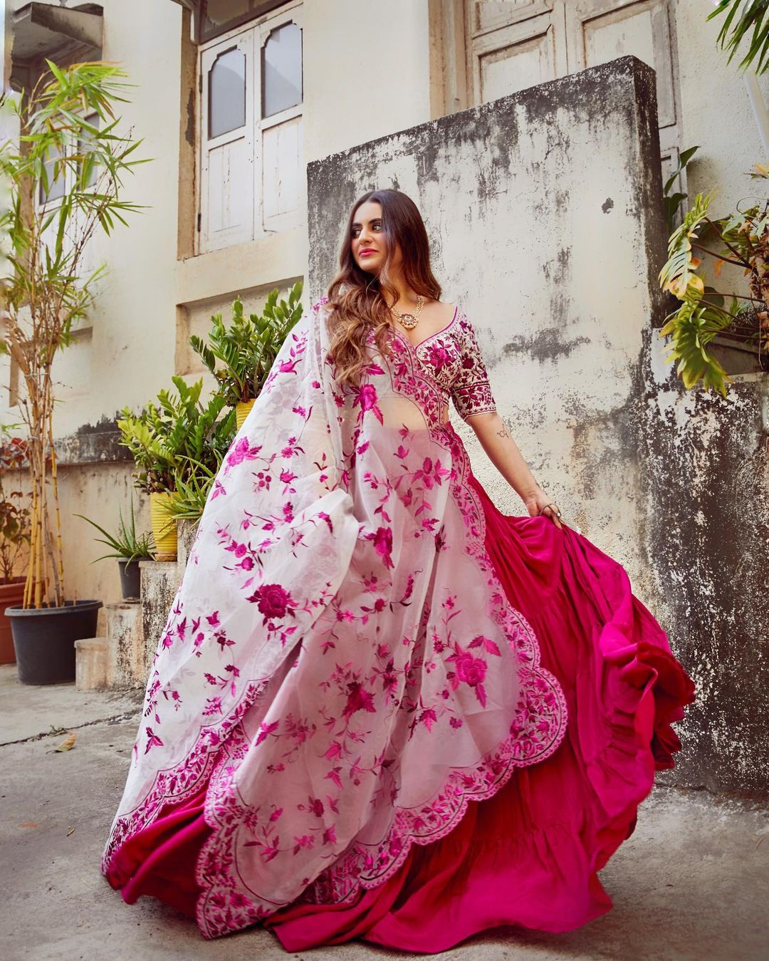 Shereen Sikka looks stunning in this Pink lehenga with Roses embroidered scalloped dupatta.